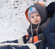 Little boy enjoying a sleigh ride Royalty Free Stock Photography