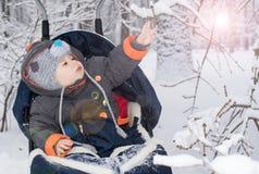 Little boy enjoying a sleigh ride Stock Images