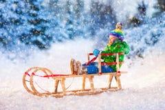 Little boy enjoying sleigh ride. Royalty Free Stock Photography