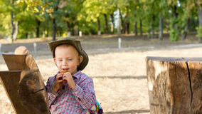 Little boy enjoying a snack outdoors Royalty Free Stock Photos