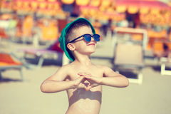 Little boy enjoying the summer holiday showing heart vintage Stock Photo