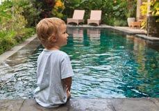 Little boy enjoying swimming pool Royalty Free Stock Image