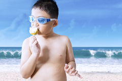 Little boy enjoying a yummy ice cream Royalty Free Stock Photo