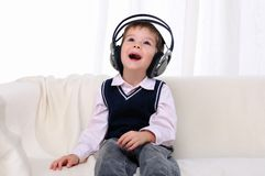 Little boy enjoys the music Royalty Free Stock Photos