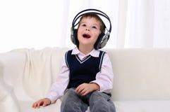 Free Little Boy Enjoys The Music Royalty Free Stock Photos - 16975098