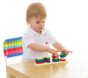 Little boy enthusiastically working with Montessori materials Royalty Free Stock Photography