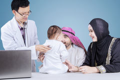 Little boy examined by a pediatrician Royalty Free Stock Photo