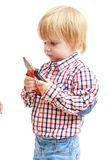 Little boy examines pliers. Stock Photography