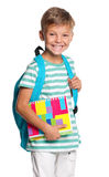Little boy with exercise books Stock Images