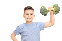 Little boy exercising with a broccoli dumbbell Royalty Free Stock Photography