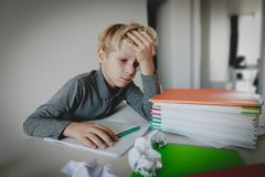 Little boy tired stressed of reading, doing homework. Little boy exhausted tired stressed of reading, doing homework royalty free stock images