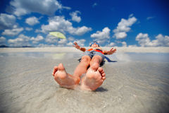Little boy on exotic beach vacation Stock Image