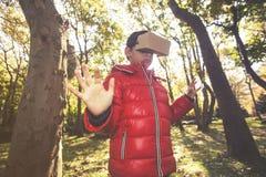Little boy experiencing virtual reality Stock Photos