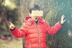 Little boy experiencing virtual reality Stock Image