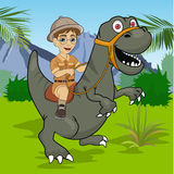 Little boy explorer riding a dinosaur velociraptor in jungle Royalty Free Stock Photo