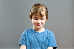 Little Boy Expressions - Funny Giggle. Series of a Little Boy, Expressions - Funny Giggle, looking Down Stock Images
