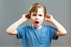 Little Boy Expressions - I can not Hear you. Series of a Little Boy, Expressions -  I can not Hear you, Holding his ears while shouting Royalty Free Stock Photo