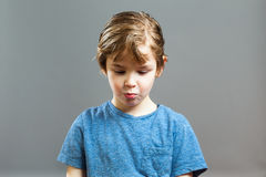 Little Boy Expressions - Rascal got caught Stock Photo