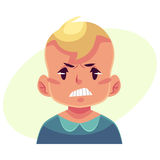 Little boy face, angry facial expression Stock Image