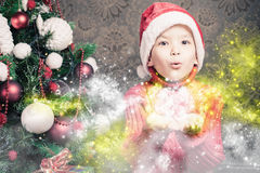 Little boy fairy blowing fairy magical glitter, stardust at Christmas Stock Images