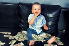 Little boy with fake money Stock Photos