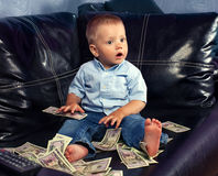 Little boy with fake money Stock Photography