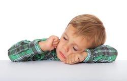 Little boy falling asleep stock image