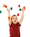 Little boy with falling easter eggs - isolated Stock Photo