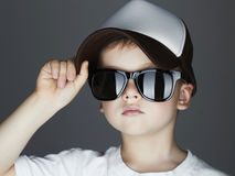 Little boy. fashion children.handsome in sunglasses and Tracker Hat. Child in Cap Royalty Free Stock Photos