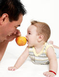 Little boy and father with an apple Royalty Free Stock Photos