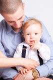 Little boy on father hands look to camera Stock Images