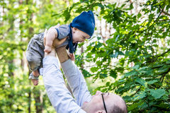 Little boy and father playing outdoors Stock Photo