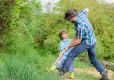 Little boy and father with shovel looking for treasures. Happy childhood. Adventure hunting for treasures. Little helper. In garden. Cute child in nature having stock images