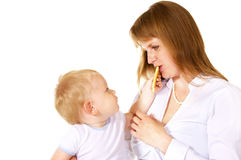Little boy feeding his mother Royalty Free Stock Photography