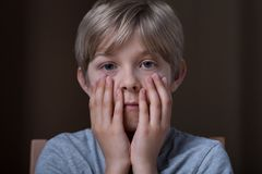 Little boy feeling afraid Royalty Free Stock Photos
