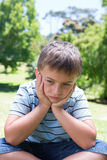 Little boy feeling sad in the park Royalty Free Stock Images
