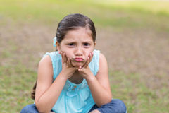 Little boy feeling sad in the park Royalty Free Stock Image