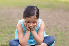 Little boy feeling sad in the park Royalty Free Stock Photography