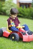 Little Boy feliz que conduce a Toy Car Fotografía de archivo