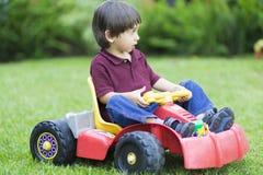 Little Boy feliz que conduce a Toy Car Foto de archivo libre de regalías