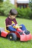 Little Boy feliz que conduce a Toy Car Imagen de archivo libre de regalías