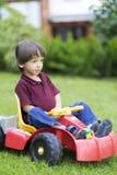 Little Boy feliz que conduce a Toy Car Fotos de archivo