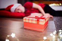 Little boy fell asleep while waiting for Santa Claus Royalty Free Stock Photos