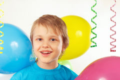 Little boy with festive balloons and streamer Royalty Free Stock Image