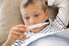 Little boy with fever Stock Image