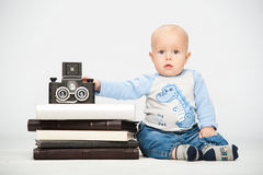 Little boy with a film camera Stock Image