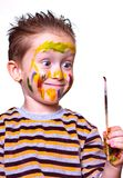 Little boy with a filthy face looking at the brush Royalty Free Stock Images