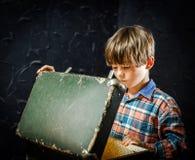 Little boy finding treasure Stock Image