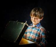 Little boy finding treasure Stock Photography