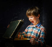 Little boy finding treasure Stock Image